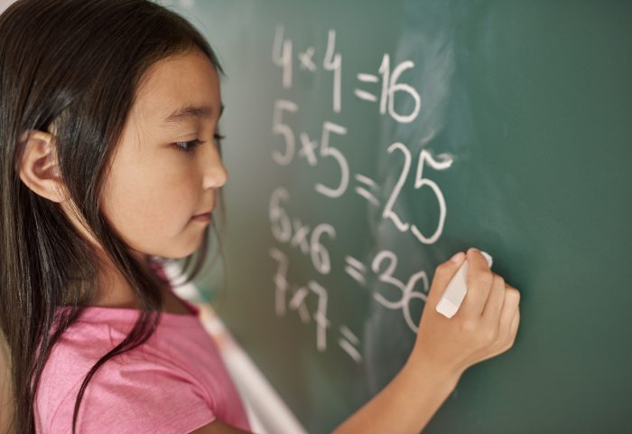 Focus girl trying to solve mathematical equation