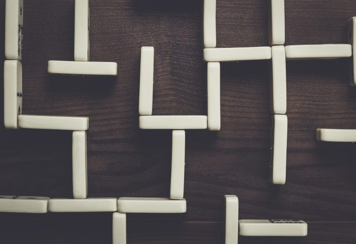 domino pieces maze on wooden table background